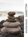 stones pyramid on sand... | Shutterstock . vector #166827704