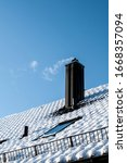 Snow Covered Roof On A Sunny...