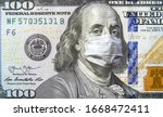 Small photo of COVID-19 coronavirus in USA, 100 dollar money bill with face mask. Coronavirus affects global stock market. World economy hit by corona virus outbreak and pandemic fears. Crisis and finance concept.