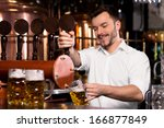 freshly tapped beer. cheerful... | Shutterstock . vector #166877849