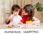 cute mother and child painting...   Shutterstock . vector #166897961