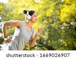 Sportswoman Listening Music An...