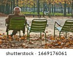 Ld Man Sitting Alone On Park...