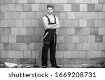 ready to work. building skills and construction. man builder in work clothes. man build house. skilled architect repair and fix. professional repairman. turnkey project. worker brick wall background. - stock photo