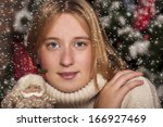 girl who keeps a toy santa... | Shutterstock . vector #166927469
