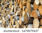 Stacked Firewood With Snow As...