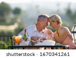 Loving Mature Couple Eating At...