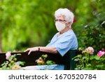 Senior woman wearing face mask...