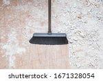 Broom sweeping concrete pieces...