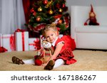 happy dreaming child holding... | Shutterstock . vector #167186267