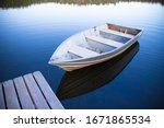 Two rowboat floating in calm...