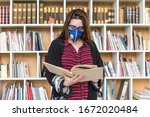 Coronavirus. Student In Librar...