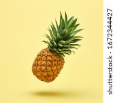 Small photo of Flying in air pineapple tropical fruit on yellow. Minamal, Vitamin pineapple, vegan dieting food. Whole sweet fresh fruit. Levitation, falling fly pineapple creative concept