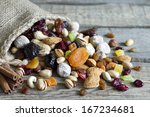 nuts and dried fruits on... | Shutterstock . vector #167234681