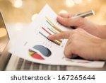 businessman analyzing... | Shutterstock . vector #167265644