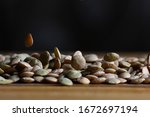 lentil grains scattered on a... | Shutterstock . vector #1672697194