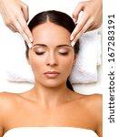 face massage. close up of a... | Shutterstock . vector #167283191