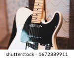 White Guitar With Black Pick...