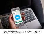 Small photo of Portland, OR, USA - Mar 14, 2020: A woman tries to create a Zoom meeting in Slack from her smartphone. Zoom and Slack Technologies are collaborating to facilitate team communication and productivity.