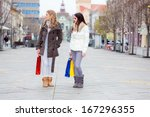 two girlfriends with shopping... | Shutterstock . vector #167296355