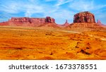 Merrick Butte, Mitten Buttes and Sentinel Mesa, a few of the massive Red Sandstone Buttes and Mesas in Monument Valley, a Navajo Tribal Park on the border of Utah and Arizona, United States