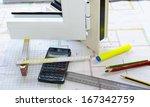 Small photo of Studies node vertical aluminium frame box with calculator, pens, pencils, and decimeter on a desktop