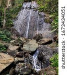 A Waterfall Cascades Peacefully ...