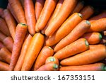 Close-up of fresh nutritive carrots, source of vitamin A and beta carotene - stock photo