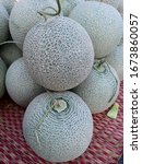 Small photo of Cantaloupe melons in market ,Cantaloupe melons background,cantaloupe melon on hay grass background.Rock melon sell in the market.
