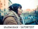 beautiful young woman listening ... | Shutterstock . vector #167387207