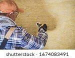 Construction Worker Insulating House. Synthetic Mineral Fibers Wall Installation.  - stock photo