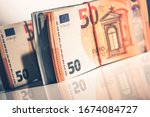 Euro Cash Money Stack on White Glassy Surface. Closeup Photo. Business and Economy.  - stock photo