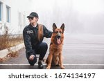 Female Police Officer With Dog...