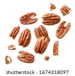 Small photo of Peeled pecans with broken halves and pieces on a white background. The view from top.