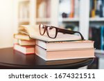Glasses On Stack Of Books....