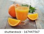 orange juice in glass with mint ...   Shutterstock . vector #167447567