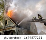 American Firefighters With Saw...