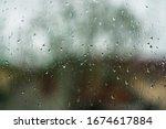 Window Overlooking A Rainy...