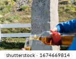 Small photo of Whiskey toast at the grave of Ernest Shackleton