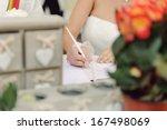 bride signing marriage... | Shutterstock . vector #167498069