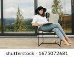 Stylish Hipster Girl Sitting...