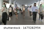 Small photo of Blured defocused. The crowd is wearing protective masks prevent Coronavirus, Covid 19 virus during virus outbreak and PM2.5 air pollution crisis rush hour Bangkok, Thailand.