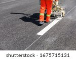 Road Workers Use Hot Melt...