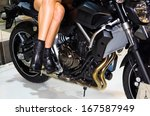 model sitting on motorbike   Shutterstock . vector #167587949