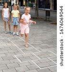 Funny Children Play Hopscotch...