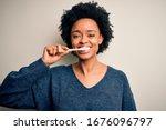 African American Woman Brushing ...