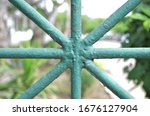 Green Iron Fence In The Garden.