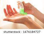 Using hand sanitizer liquid to...
