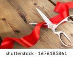 Scissors cutting the red ribbon ...