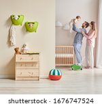 Happy Family In The Baby Room...